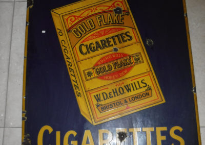 A 1930s Will's Gold Flake enamel sign