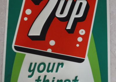 A 1963 7up embossed metal tin sign