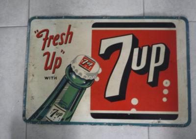 A 1960s 7up metal sign